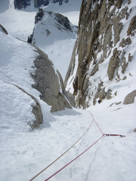 Looking down past an excellent ice screw to Steve at the belay. <br/>