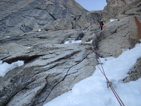 Steve at the 1st belay above the steep snow and the rock crux. Pro for...