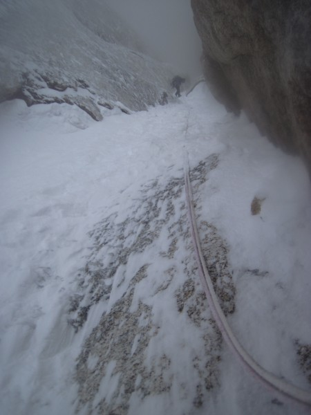 A couple of rappels to go. Steve rappelling between spindrift avalanch...