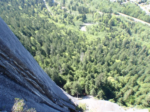 Graham starting up the pitch with Squamish forest spread out in the ba...