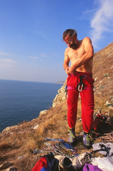 Harnessing up for a day of sea-cliff climbing