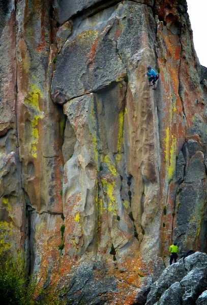 Climber on Cairo 11a with the finger crack Thin Slice 10a to her left,...