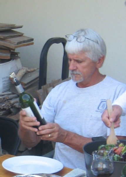 He holds a wine bottle like a samurai sword!