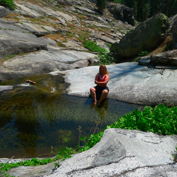 Amy is super psyched on soking her toes at the swimming hole.