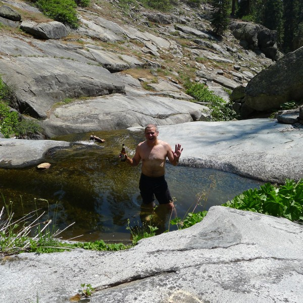 Mike A. with a cold beer at the swimming hole :-)
