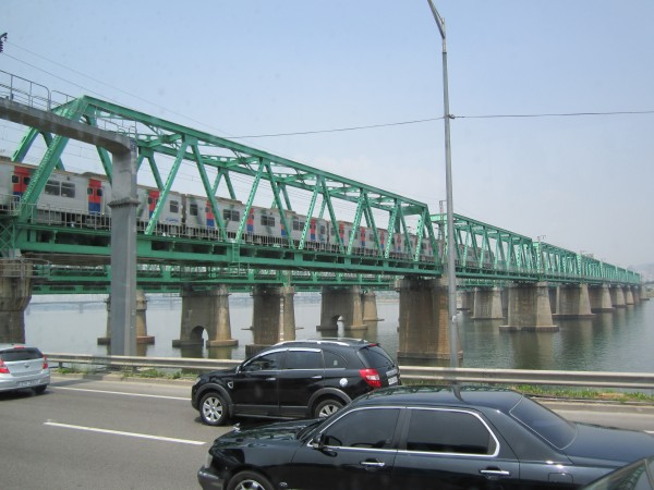 Seoul train bridge while sitting in one of the 24 rush hours they have...