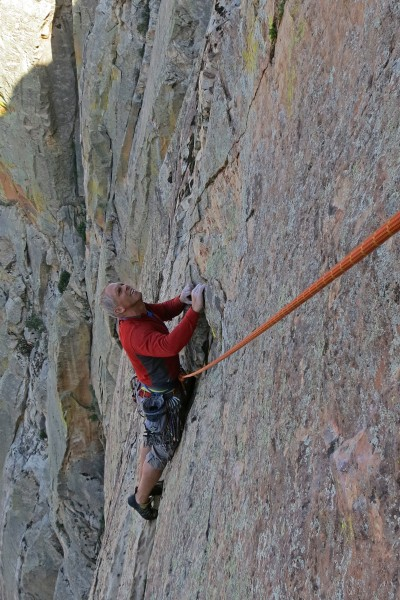 P12 starts with some diagonal down-climbing from the belay.
