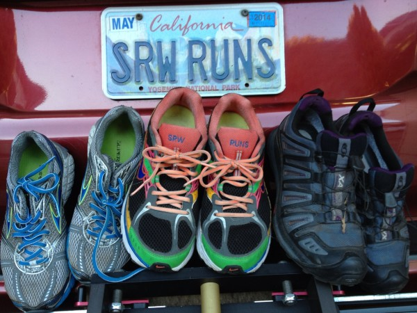Current cache of road and trail running shoes on the back of my 4Runne...