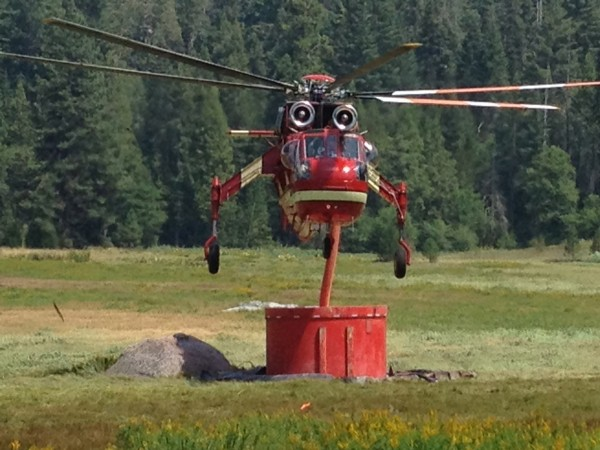 Sikorsky S-64E at a retardent dip site