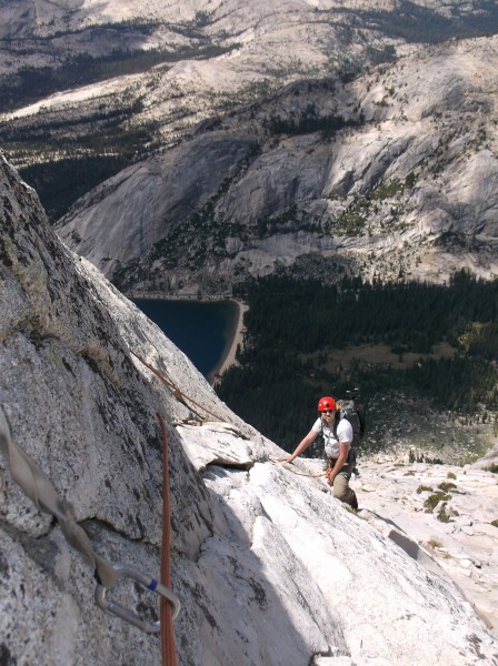 Andrew DeSimon following pitch 13.  Tenaya Lake far below.