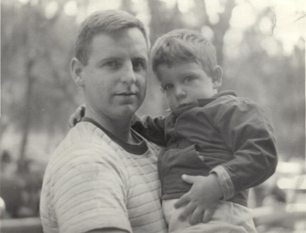 T. Charles as a child in his father's arms.