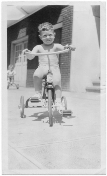 couldn't help myself-had to post Tommy as a young tike on his trike in...