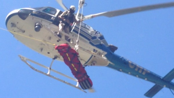 CHP hoisting injured climber.