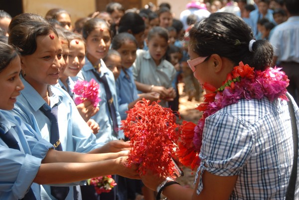 My wife receiving handmade flower leis at a school we brought chairs t...