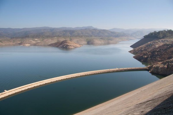 The top of Exchequer Dam shows above the low reservoir level.  Photo t...