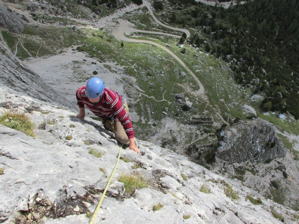Traversing upwards to the final arête.