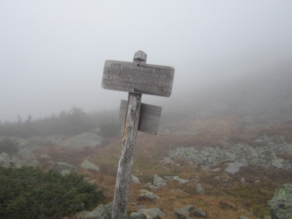 Trail junction signs were welcome waypoints on the cloudy ridge