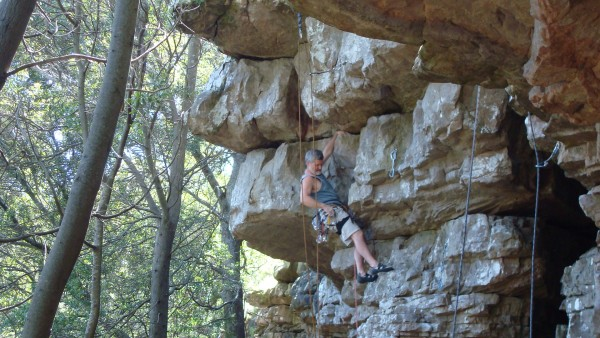 The old fat guy places a red Camalot on a steep 10a