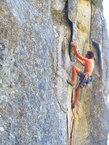 alejo walking the second ascent of a 12a mixed route at fifi