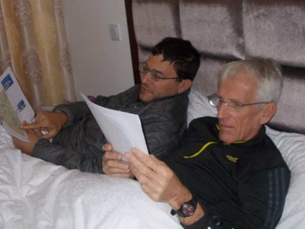 Phil and I planning the trip in his Beijing apartment...Angela was sho...