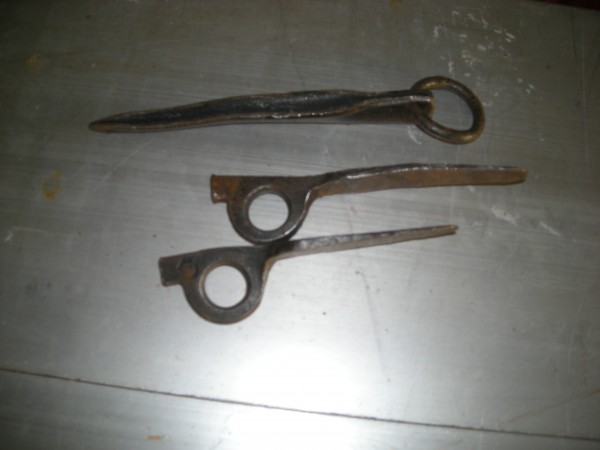 Old ring pitons by Eritch Zurich. Soft hand pounded ones are two sizes...