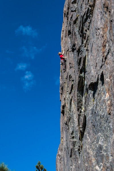 Ollie finishing up Scout's Honor .11a. Boy Scout Wall, Bowman Lake, CA...