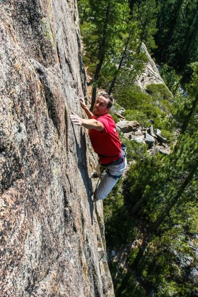 Josh Horniak on Scout's Honor .11a Boy Scout Wall, Bowman Lake, CA.