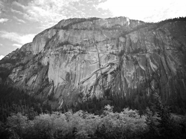 The Grand Wall climbs the unbroken face of The Chief in the left cente...