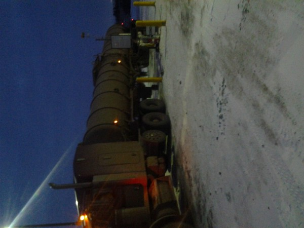 Oil hauling in the snow baby