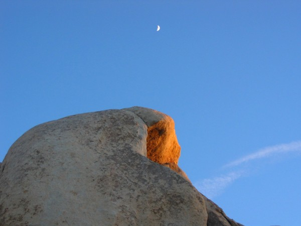 Intersection Rock at sunset with half-moon