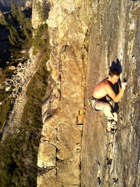 Josh Horniak, topping out. FA: High Lands .10, Bowman Lake Valley, CA.