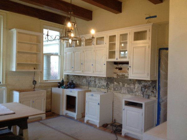 The large wall hung cabinets probably weighed 500+ lbs.