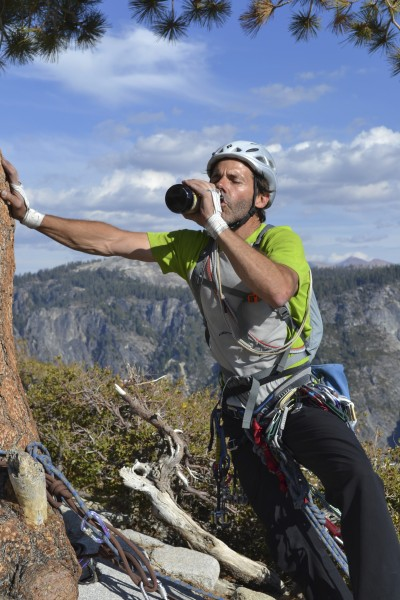 Steve chugging a Sierra Nevada with his hand on El Cap Tree after summ...