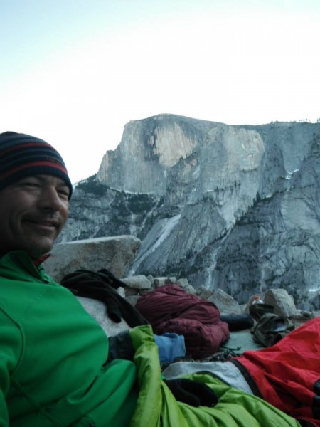 Wes enjoys the view of snow-trimmed Half Dome from Dinner Ledge as the...