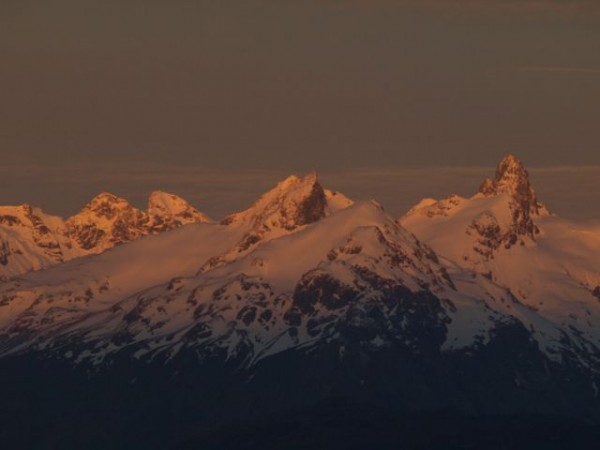Did the first ascents of the two peaks on the right.