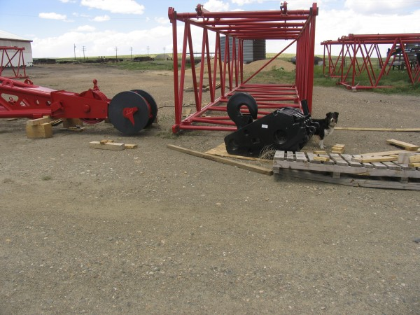 The unassembled crane tractor and the moving shev block.