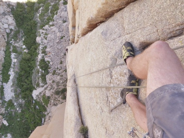Looking down pitch 3 of Rites of Spring, Pine Creek, CA.