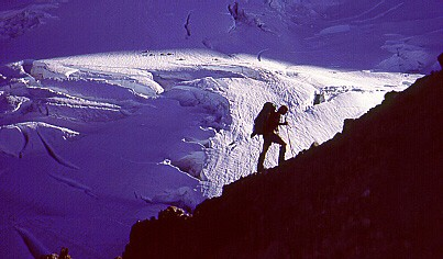 Chad silhouetted against the Emmons Glacier on Steamboat Prow.
