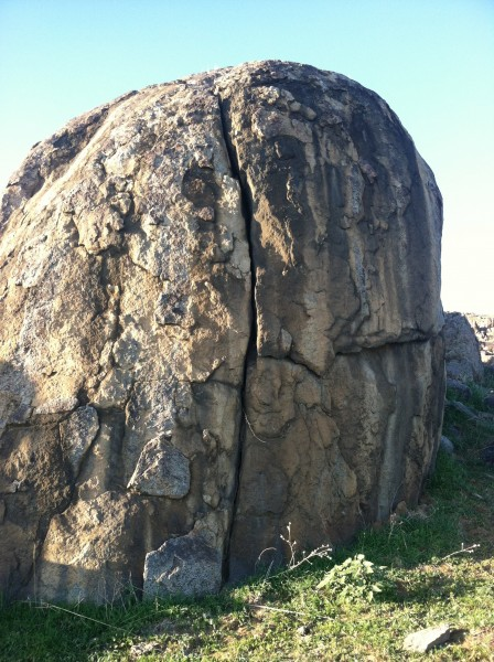 Choss with solid crack in the front.  Good rock with edges in the back...