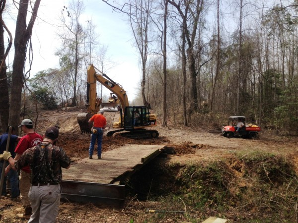 Building up dirt ramps to bridge height.
