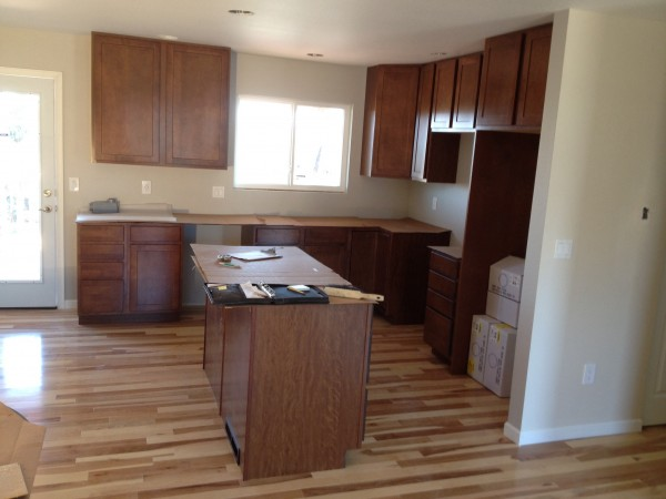 Maple cabinets, hickory floor, stock door and trim (ick), and ...