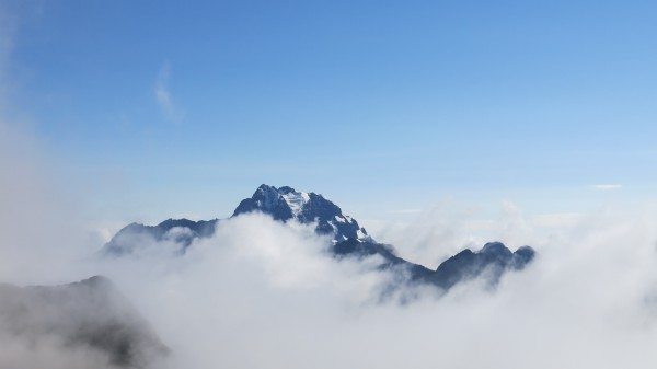 Clouds swallowing Tiquimani, unclimbed for at least a decade.