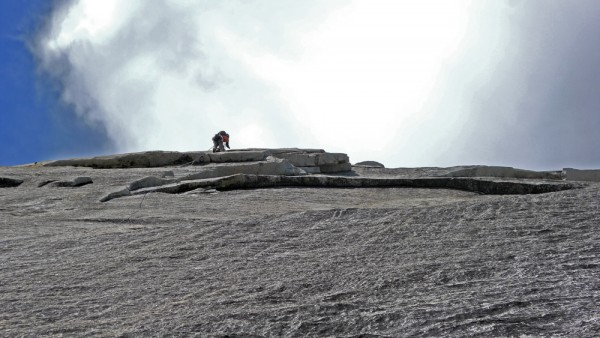 Dr. Sharpe on his end of the rope, topping out on South Crack, Tuolumn...
