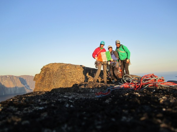 Summit photo, we were too tired to realise that we were holding the Ir...