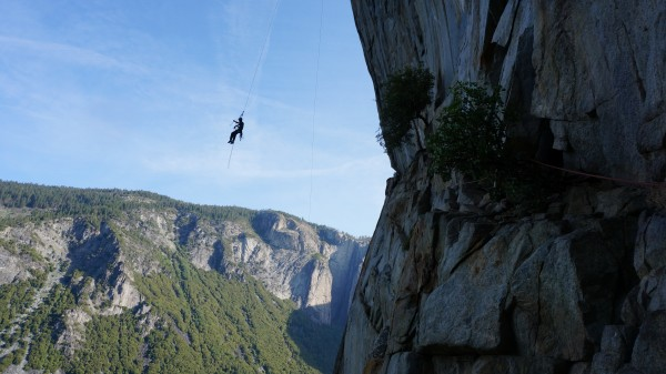 Nathan swinging out on the 1st pitch of the West Face of Leaning Tower...