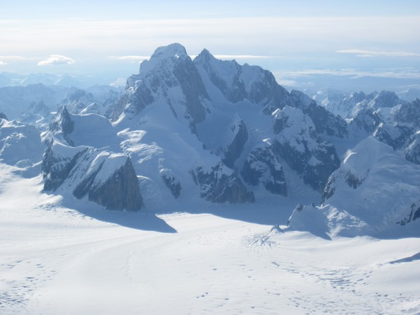 A tele-shot of the Moose's Tooth massif from the west on Peak 11,300 &...