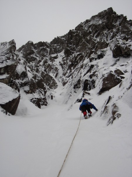 Susan approaching steeper terrain with icy and mixed bits above - on G...
