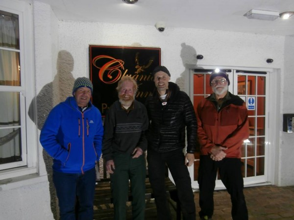 Dave snapped this pic of Sandy, Andy, Steve, and me outside the Cluani...