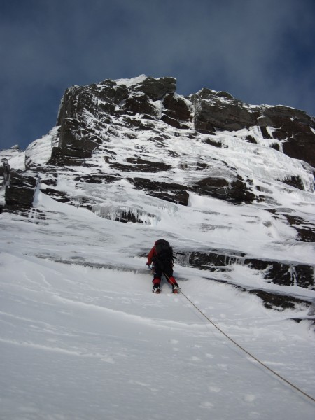 Susan heading up our route - the Sermon - steep ice and snow to the le...