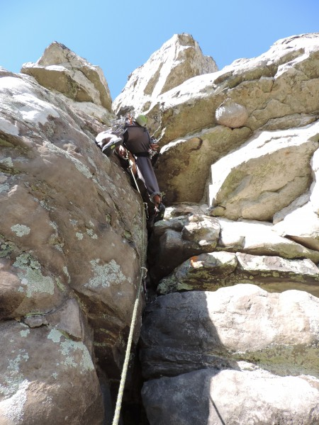 Classic butt shot taken while belaying on a best-first-ascent-style fi...
